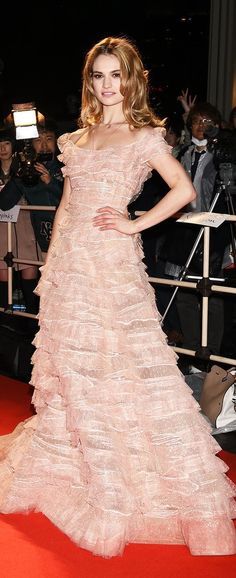Lily James had a princess moment wearing a blush colored Elie Saab gown on the red carpet at the Cinderella premiere in Tokyo