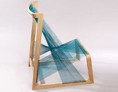 This chair is made from a wooden frame strung with strands of silk! I wonder how comfortable/supportive it would be, but, either way, it looks stunning.