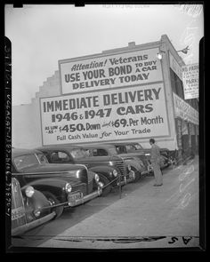 "Kelley Kar Company dealership, sign on side of building reads ""Attention! Veterans use your bond to buy a car"" in Los Angeles, Calif., 1947. Tumblr"