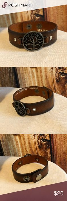 """""""Tree of Life"""" Brown Leather Bracelet ☺️🌳☺️ Adjustable brown leather """"Tree of Life"""" bracelet with rhinestone accents!!! Great piece to throw on with any casual outfit! Even looks cute with a boho dress or flowy skirt!!  Genuine Leather  Adjustable! 2 different snaps depending on wrist size (see pics).   Measurements are bracelet laying flat. First snap: 8 1/2 inches Second snap: 7 1/2 inches  Total Length: 9 inches  Used but like new condition!!! No tears or scratches. Jewelry Bracelets"""