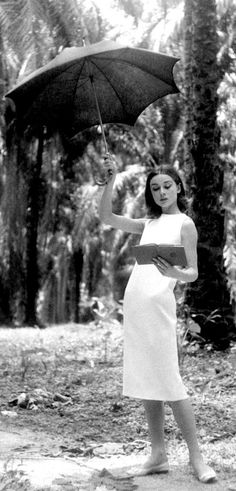 Audrey Hepburn reading a book.