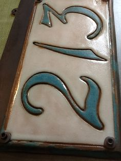 Items similar to MADE TO ORDER-Ceramic tile only- Custom address tile with 4 numbers (not mounted on steel plate) on Etsy Ceramic Wall Art, Ceramic Plates, Ceramic Pottery, Pottery Art, Ceramic House Numbers, Tile House Numbers, Pottery Houses, Ceramic Houses, Handmade Tiles