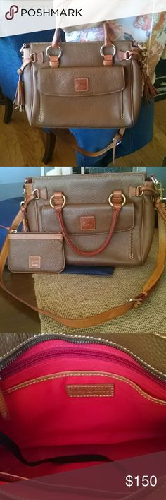 Dooney & Bourke Handbag Saddle Tan brown Dooney & Bourke handbag. Approx 9x12 . Dust jacket is included. Long strap included and can be removed. Three inside pockets and a zipper pocket. Change purse included as well. Barely used, great condition. Dooney & Bourke Bags Satchels