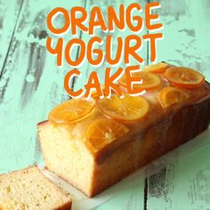 Moist orange yogurt cake loaf with candied oranges and an orange glaze