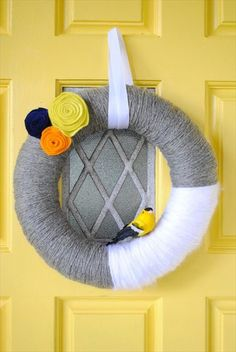 DIY yarn wreaths are easy to make and won't hurt you budget.