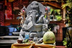 Stone statue of the Hindu diety Ganesh or Ganesha, Remover of Obstacles and the patron of arts, sciences, intellect and wisdom. Bali, Indonesia