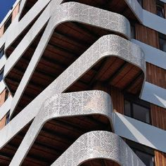Perforated metal balconies fold like ribbons around the facade of an apartment block in the Dutch city of Nijmegen.The irregularly shaped balconies project from each corner of the tower, which was recently completed by Rotterdam studio architecture. Organic Architecture, Facade Architecture, Amazing Architecture, Parametric Architecture, Installation Architecture, Architecture Wallpaper, Metal Facade, Metal Panels, Ard Buffet