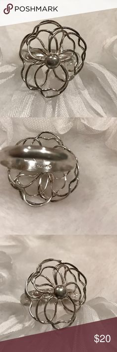 Sterling Silver Wire Flower Ring 5 3/4 The sterling silver flower ring is simply adorable. It's almost a size 6 as shown in the photo. It is marked 925 inside. Jewelry Rings