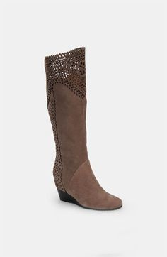 An exquisite over-the-knee suede mauve grey boot with intricate laser-cut accents is styled with a wedge heel and outfitted with a signature comfort footbed.