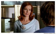 Bree's baby blue sweater and brooch