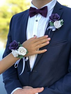 Roses are made from fabric, they look and feel realistic but never fade. Prom Corsage And Boutonniere, Bridesmaid Corsage, Corsage Wedding, Flower Bouquet Wedding, Corsages, Purple Wedding Colour Theme, Prom Couples, Prom Flowers, Prom Pictures