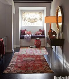 A series of small entryway rugs is perfect for a narrow space, like a long hallway.