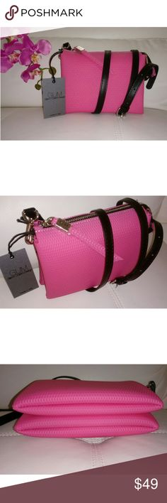"GUM by Gianni Chiarini Design Cross-body bag GUM by Gianni Chiarini Design Cross-body bag with print in relief.   * Rubber Zipper pull with Company Logo bar * Zip fastening & Adjustable strap (strap is 55"" in total and can be reduced to 45"") * Dimension 8"" L x 6"" H X 3"" W * Pink  * Made in Italy GUM by Gianni Chiarini Bags"