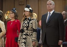 Being respectful:Princess Eugenie (left), Princess Beatrice (centre) and the Duke of York during a reception at the Guildhall, London
