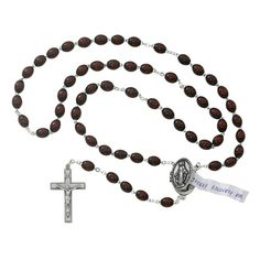 Classic design and practical too! This rosary centerpiece is a locket and you can keep a small prayer intention inside. The beads are brown oval wood. The crucifix is simple and handsome. The Length is 22 inches Crucifix Measurement 1.67 x 1.06 x 0.18 inches Crucifix Material is Silver Oxidized Centerpiece Measurement 1.12 x 0.84 x 0.21 inches Centerpiece Material is Silver Oxidized Wood beads are used for this rosary Bead size is 6 x 8 mm Bead color is Brown Packaged in a deluxe gift box