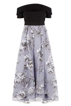 This beautiful dress is a true show stopper. The Yaya Printed Dress features a bardot neckline and a catwalk inspired floral skirt with statement volume. The subtle pleats at the waist create a modern look whilst the tulle under skirt creates exaggerated fullness and dramatic flaring. The vibrant luxe pattern on the skirt adds a modern touch, whilst the waist band secures with two popper buttons for the perfect fit. Finishing with a concealed back zip this piece measures 47.6 inches/121cm…