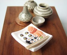 Miniature sushi made out of polymer clay.