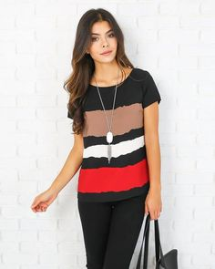 Another work to weekend for the win! Our Dixie Striped Top is too cute in black with abstract beige, white and red stripe stripes going across the center front.