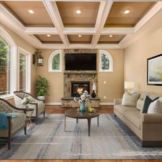 Inviting family room upgraded with stone, gas fireplace, coffered ceilings highlighted with recessed lights, plenty of natural light from the custom arched windows. Listed for $1,250,000 in Oakton, VA by The Casey Samson Team is a Wall Street Journal Top Team in Northern Virginia.