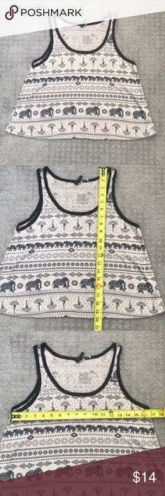 Metallic 49 Tan & Black Elephant Tribal Crop Tank Festival Ready! Boho Chic, Tribal tank top. Super cute and soft Tank with elephants and tribal design. Light linen feel that is somewhat See thru - See pic.   🔴 There is NO SIZE label on this top. PLEASE see measurements and let me know if you'd like more!!  I am sizing it as a Medium as this top is intended to be a more loose fit. Length measurements makes me lean more to a crop top than a normal length tank 🔴  Open to offers Metallic 49…