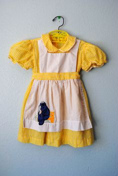 vintage girl yellow gingham dress