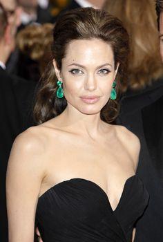 Celebrity Jewelry Trend: Colorful Statement Earrings like these Emerald drop earrings worn by Angelina Jolie