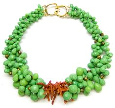 Helga Wagner Variety of green beads and drops, including dyed Jade, Malachite, Gold Coral, orange Coral center and Tiffany clasp.