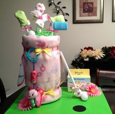 One of my favorite diaper cakes yet!  Golf themes for a little girl.