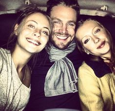 Willa Holland (Thea), Stephen Amell (Oliver),  Katie Cassidy (Laurel) behind the scenes of Arrow.