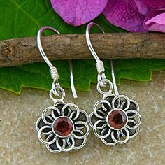 @Overstock.com.com - Sterling Silver Garnet Flower Earrings (Indonesia) - Show off your unique style with these garnet flower earringsEarring features gemstones set in .925 sterling silverHandmade jewelry designed and crafted by talented Indonesian artisans  http://www.overstock.com/Worldstock-Fair-Trade/Sterling-Silver-Garnet-Flower-Earrings-Indonesia/4070670/product.html?CID=214117 $26.59