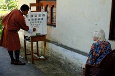 An albino child having her vision tested during a Sight For All survey in eastern Bhutan