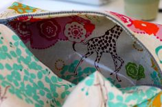 "The ""Boxy Cosmetic Bag""...there have been a ton of these tutorials on Pinterest, but I like this one because she uses oilcloth and it's an especially large bag!"