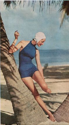 Jantzen vintage swimsuit with white bathing cap. Photo by Mark Shaw for June 1957 McCalls.