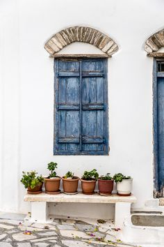 2 Days in Tinos, Greece - What to Do and See on the Island - Blue shutters and flower pots on a house in the pretty village of Pyrgos on the island of Tinos in - Tinos Greece, Greece House, Blue Shutters, Country Shutters, French Style Homes, Rustic Italian, European Home Decor, Sgraffito, Decoration Design