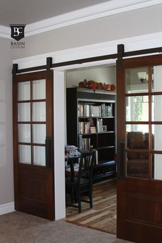 We both absolutely want this in place of swinging french doors. and with window panes for light and brown for texture and color off bright and light walls and molding