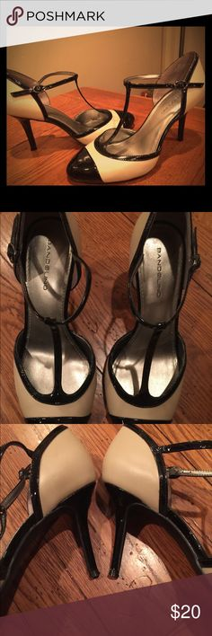 Bandolino tan and black heels- size 9. Never worn- wrong size was purchased!  Fabulous shoe! Bandolino Shoes Heels