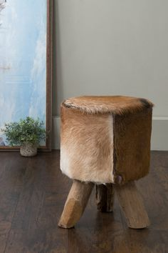 Invite rustic or modern organic design into your home with the East At Main Nellie Natural Hide Stool . For style, this stool is wrapped in natural. Cottages By The Sea, Organic Modern, Natural Brown, Teak Wood, Foot Rest, Home Living Room, Furniture Decor, Home Remodeling, Stool