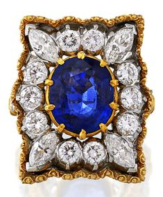 SAPPHIRE AND DIAMOND RING, FEDERICO BUCCELLATI, CIRCA 1990  The rectangular 18ct yellow and white gold plaque centring an oval cut sapphire claw set within a surround of marquise and round brilliant cut diamonds to a scalloped textured gold frame and bi-coloured hoop, signed Federico Buccellati