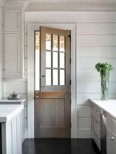 All white kitchen and could stain my dutch door to look like this!