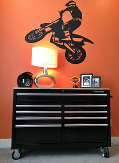 Finishing up Bubba's room.  Since he rides a KTM we had to go with a KTM orange accent wall.  And of course to tie into the Motocross theme, what boy wouldn't want a tool box for a dresser!  #twinoaks
