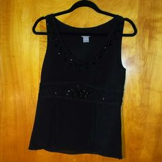 Ann Taylor beaded black sleeveless top AT sleeveless top with beaded accents size 6. Bead work intact. Hidden side zip. Fully lined. Silk shell. Excellent condition. The second pic is washed out by the flash. Ann Taylor Tops Blouses