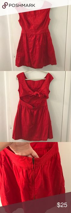 RED Tulle Dress with back cut out 😻😻Adorable alert 🚨 this dress has a bow, pockets, and the back cut out plus stretch! Very comfortable, cute, and a hidden touch a sexy. Tulle Dresses Midi