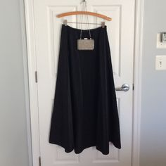 """Ralph by Ralph Lauren Sparkle Party Skirt Excellent condition. Shiny black lightly crinkled fabric. Gunmetal beading around the waist. Side zip. Pair with a sparkly crop top or a crisp white shirt for the holidays. Very versatile, very full. Approximately 39"""" long. Scoop it up before someone else does! Ralph Lauren Skirts"""