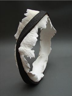 Ceramic art sculpture | black and white ceramic sculpture | organic circular artwork