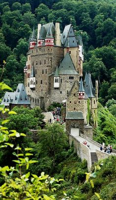 Burg Eltz castle Burg Eltz is a medieval castle nestled in the hills above the Moselle River between Koblenz and Trier, Germany. It is still owned by a branch of the same family that lived there in the century, 33 generations ago. Places Around The World, Oh The Places You'll Go, Places To Travel, Places To Visit, Around The Worlds, Beautiful Castles, Beautiful Buildings, Beautiful Places, Wonderful Places