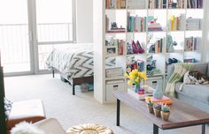 NEED THIS BOOKSHELF: Cait Weingartner's Chicago Studio Tour // small space // room divider // @IKEA USA bookshelf // coffee table styling // @west elm chevron duvet // photography by Stoffer Photography