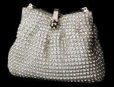 """Vintage Silver Clear Crystal Evening Bag. Featuring hundreds of sparkling clear crystals set on an elegant mesh fabric and the framed top is secured with a charming magnetic look which opens to a single compartment with a slip wall pocket and a hidden silver chain strap.  6"""" long X 2"""" wide X 5"""" deep."""