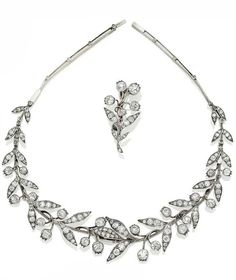 """Lily of the valley"" diamond necklace by Boucheron. Formed of branches and lily flower, set with old cut diamonds, back in double thread knife cut diamonds, dotted with roses, 37.5 cm, silver and gold setting, around 1893, the central part can be worn as a brooch, accompanied by the original invoice"