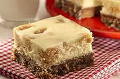 Try our Peanut Butter Cheesecake Recipe and enjoy the cookie crust. Our Peanut Butter Cheesecake Recipe is served in squares for hand-held enjoyment. Lemon Cheesecake Bars, Cheesecake Squares, Peanut Butter Cheesecake, Peanut Butter Recipes, Cheesecake Recipes, Dessert Recipes, Cookie Cheesecake, Cheesecake Bites, Cookie Recipes