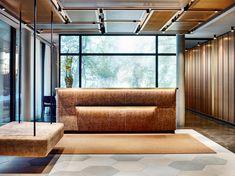 reception counter in leather, slat walls, lamella walls, backlit glass element, metal ceiling